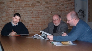 The management team of Grain & Feed Marketing making plans for the Summer issue. Pictured are (left to right) Christopher Clukey, Floyd K. Roberts and Ben Luedtke.